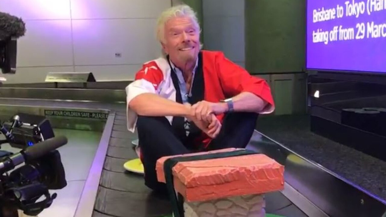 Sir Richard Branson arrives in style at the Brisbane Airport to celebrate Virigin securing a route into Haneda airport.