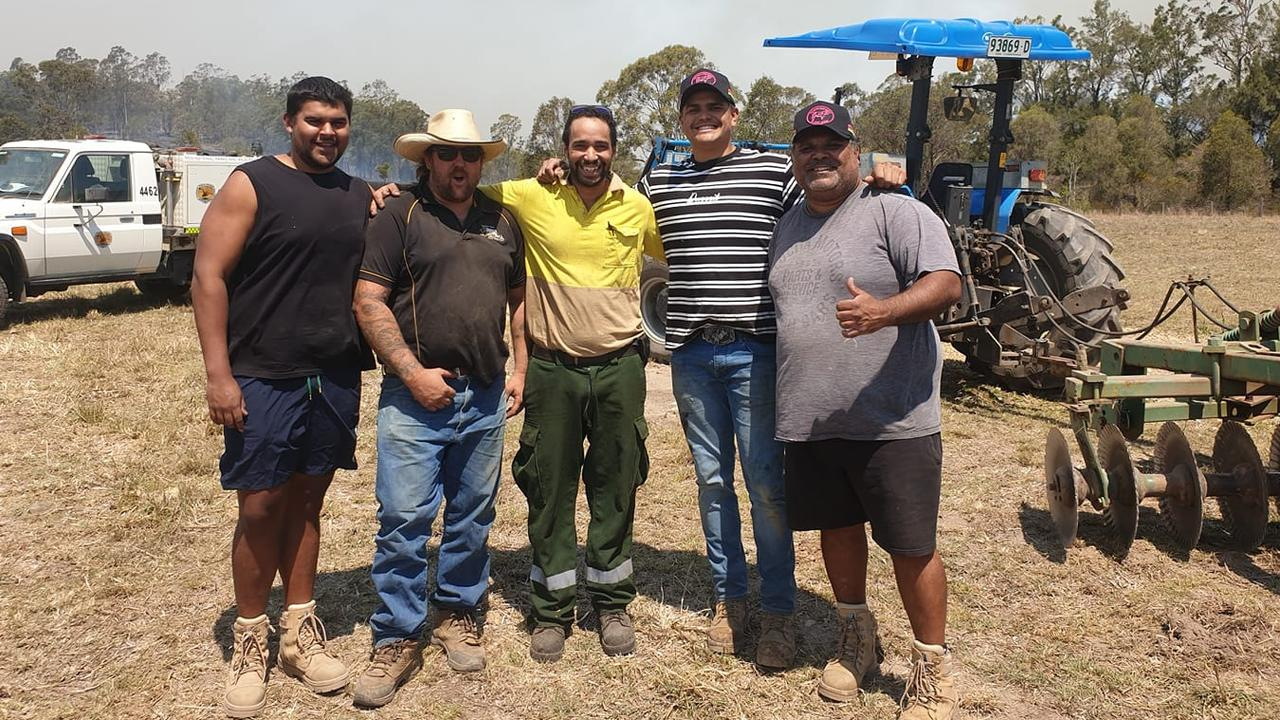 Latrell Mitchell (second from right) with family and friends helping out with the fires in Taree. Picture: Facebook