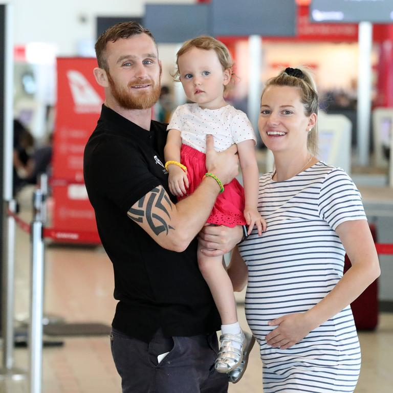 World boxing title challenger Dennis Hogan with his pregnant wife Brideen and daughter Aria at Brisbane Airport. Photographer: Liam Kidston.