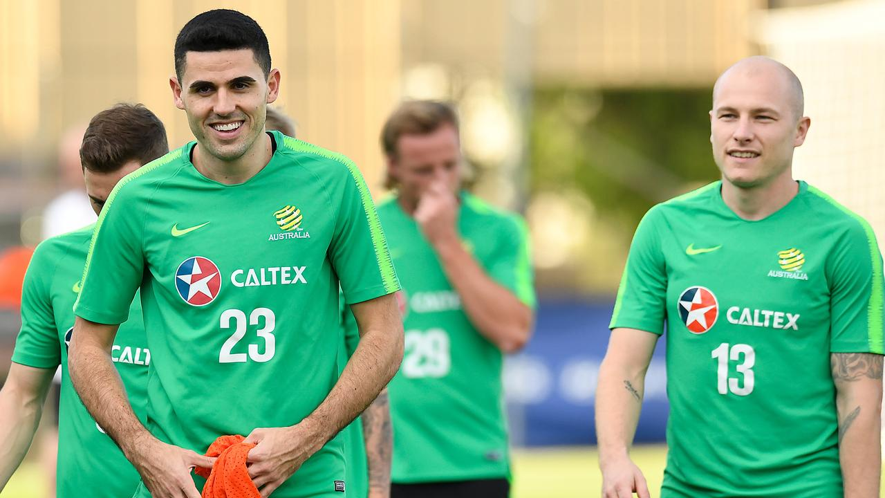 Tom Rogic (left) and Aaron Mooy (R) will command Australia's midfield. Picture: AAP