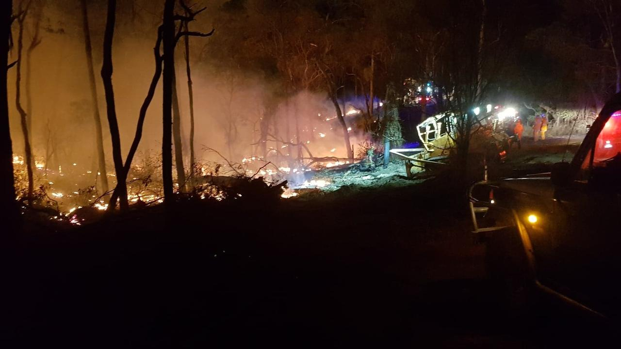 COURAGEOUS EFFORT: Fireys worked all night backburning at Upper Thorneside Rd near Widgee.