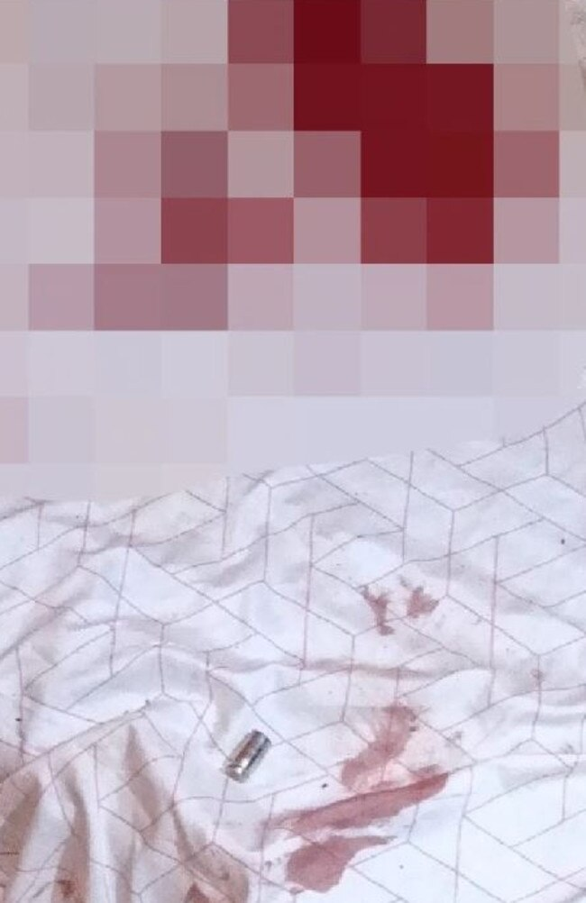 A blurred picture of a blood stained mattress where Kumanjayi Walker was allegedly shot, along with a police bullet casing. The picture was provided by the family of Kumanjayi Walker.