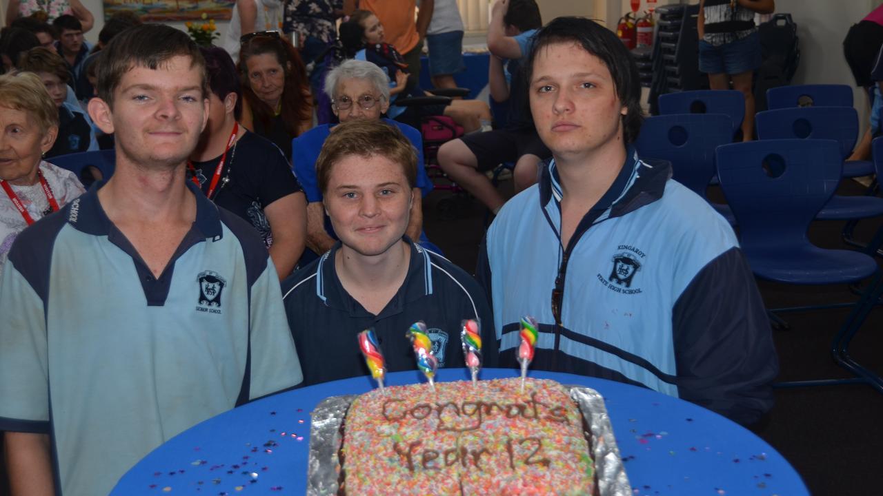 Jessie, Matthew, and Ben with their graduation cake.