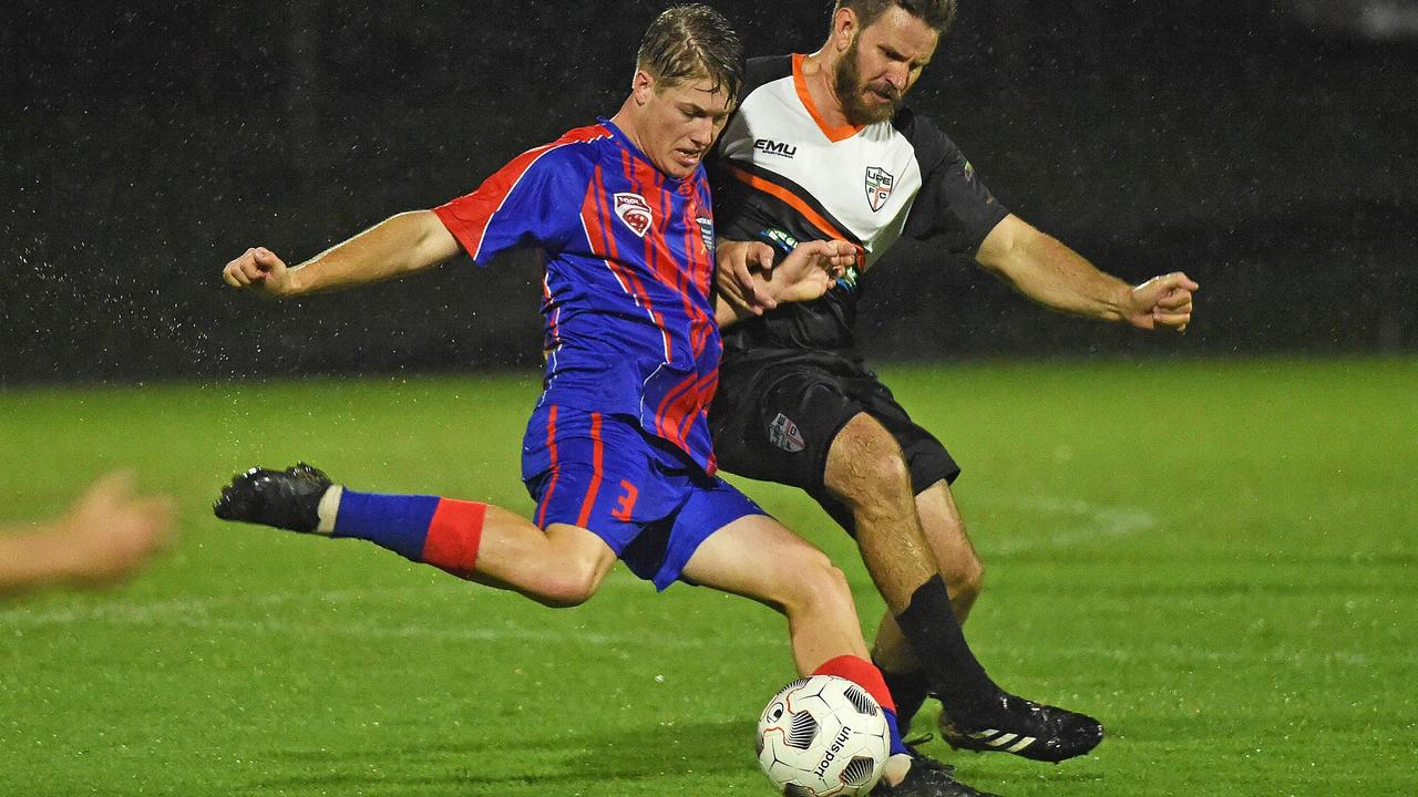 FFA Cup - United Park Eagles (Black) v Wide Bay Buccaneers (Blue) - Brad Blackwell attampts a tackle on Steve Rankin (Buccaneers). There will be no side in seniors next year for the Wide Bay Buccaneers