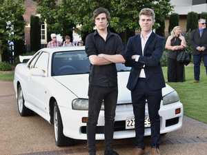Brendan Amps (left) drove his brother and graduate Jy
