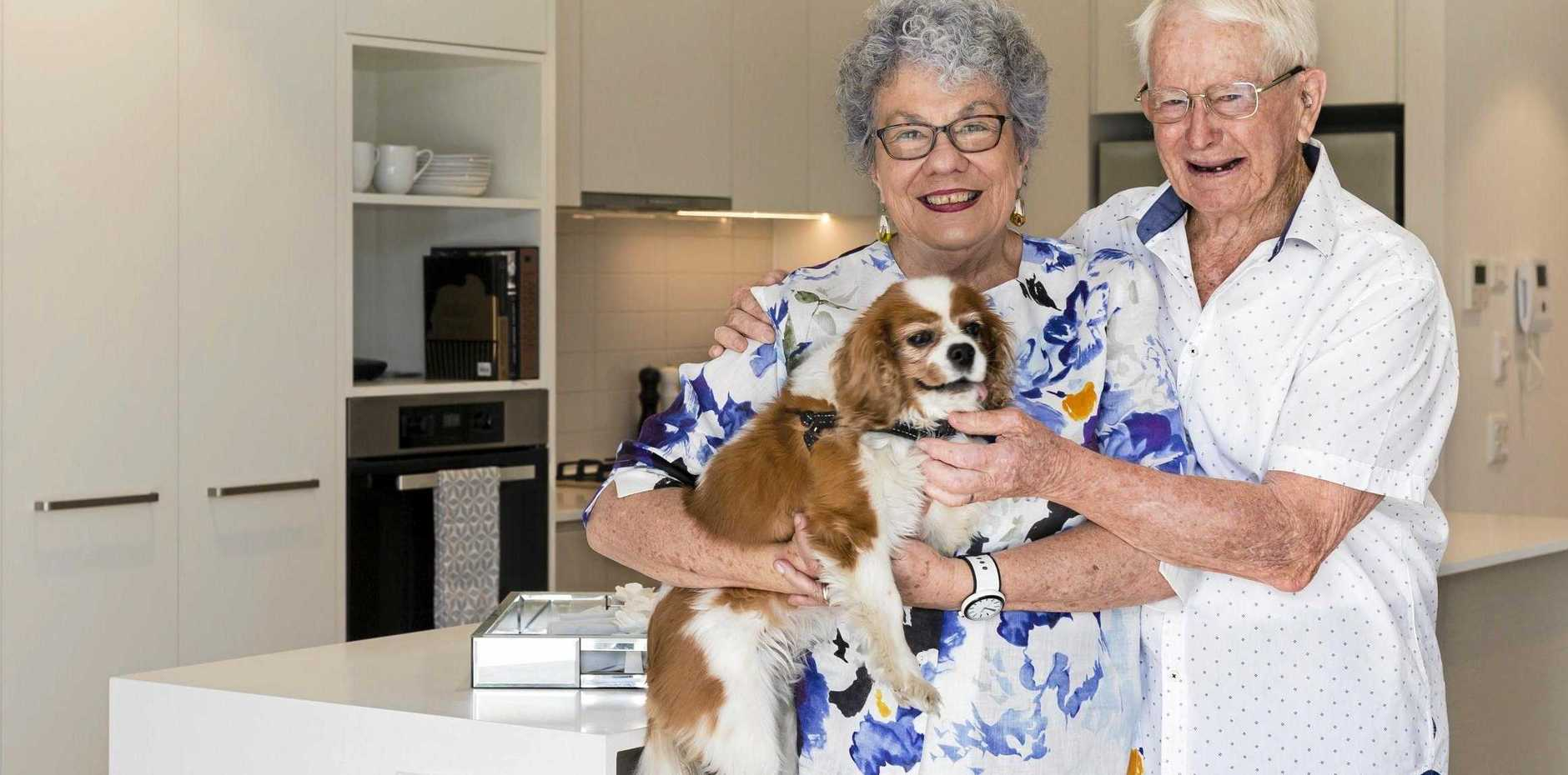 HIGH-TECH AGEING: Sue Kane, husband Leo and dog Poppy make themselves at home checking out the new smart apartment, which developers say is the way of the future for residents to