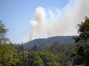Mt Nardi man completely oblivious to bushfire burning nearby
