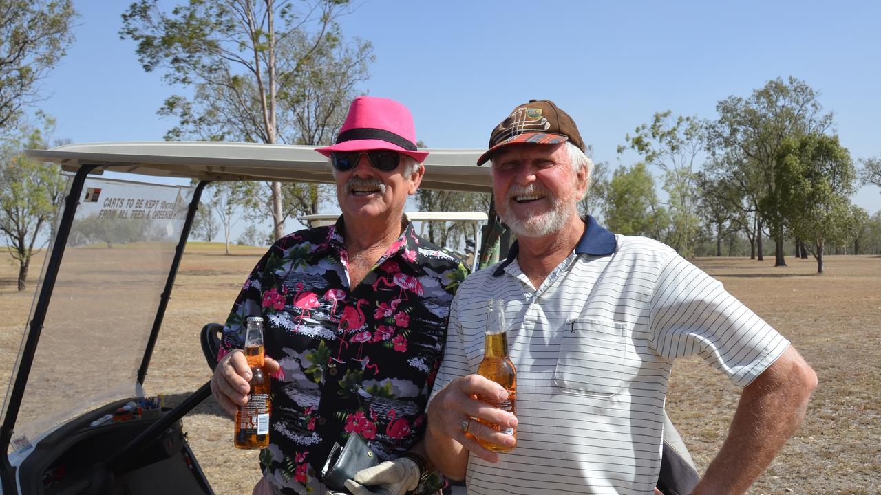 PUTTING FOR FUNDS: Ian Maskovich and Garnet Keune at the Mundubbera Rotary Golf Day. Credit: Sam Turner.