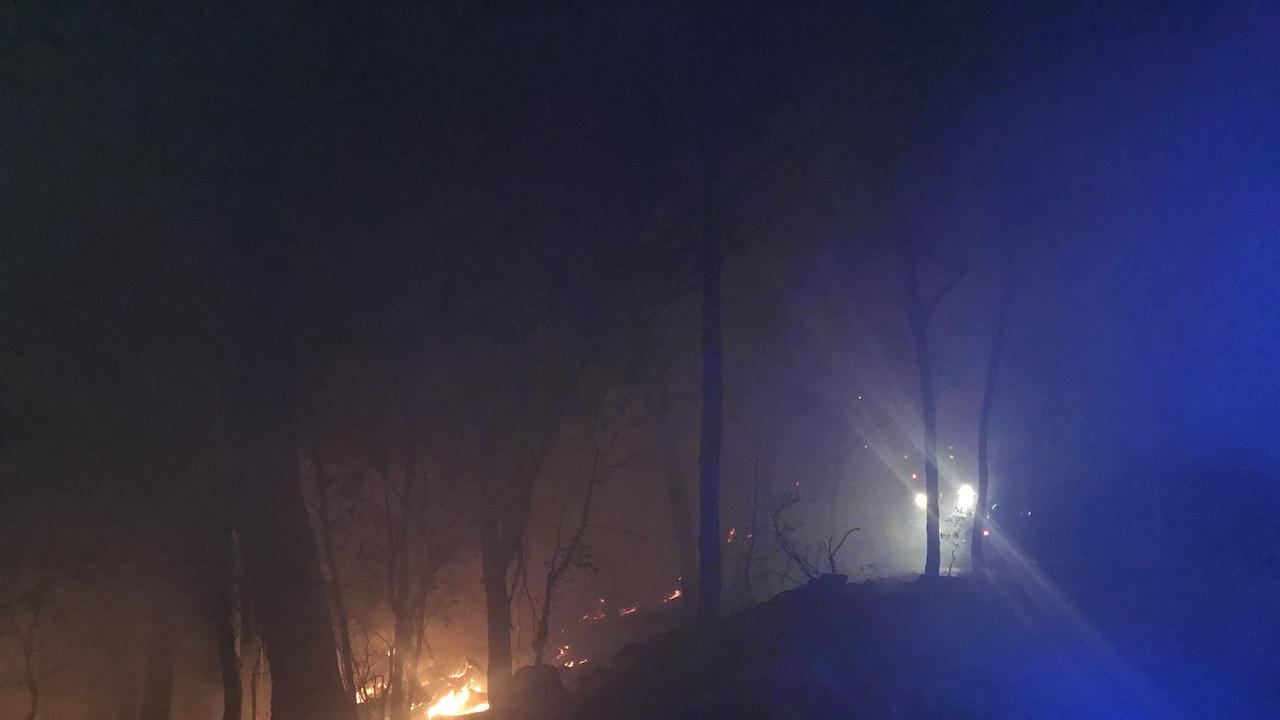 The bushfire burning near Widgee on Wednesday night, when fire crews worked tirelessly through the night to put in containment lines.