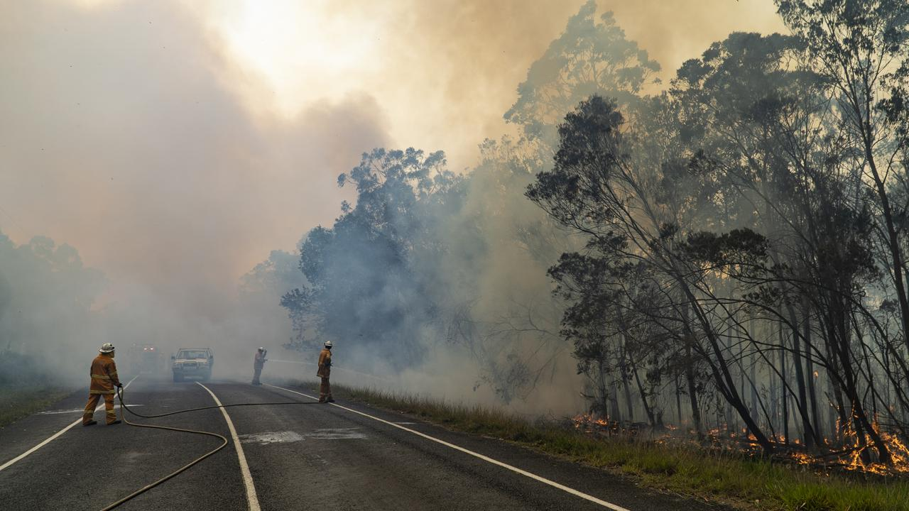FAR FROM OVER: Brigades battle the blaze long after the motorists have been evacuated. Picture: QFES.