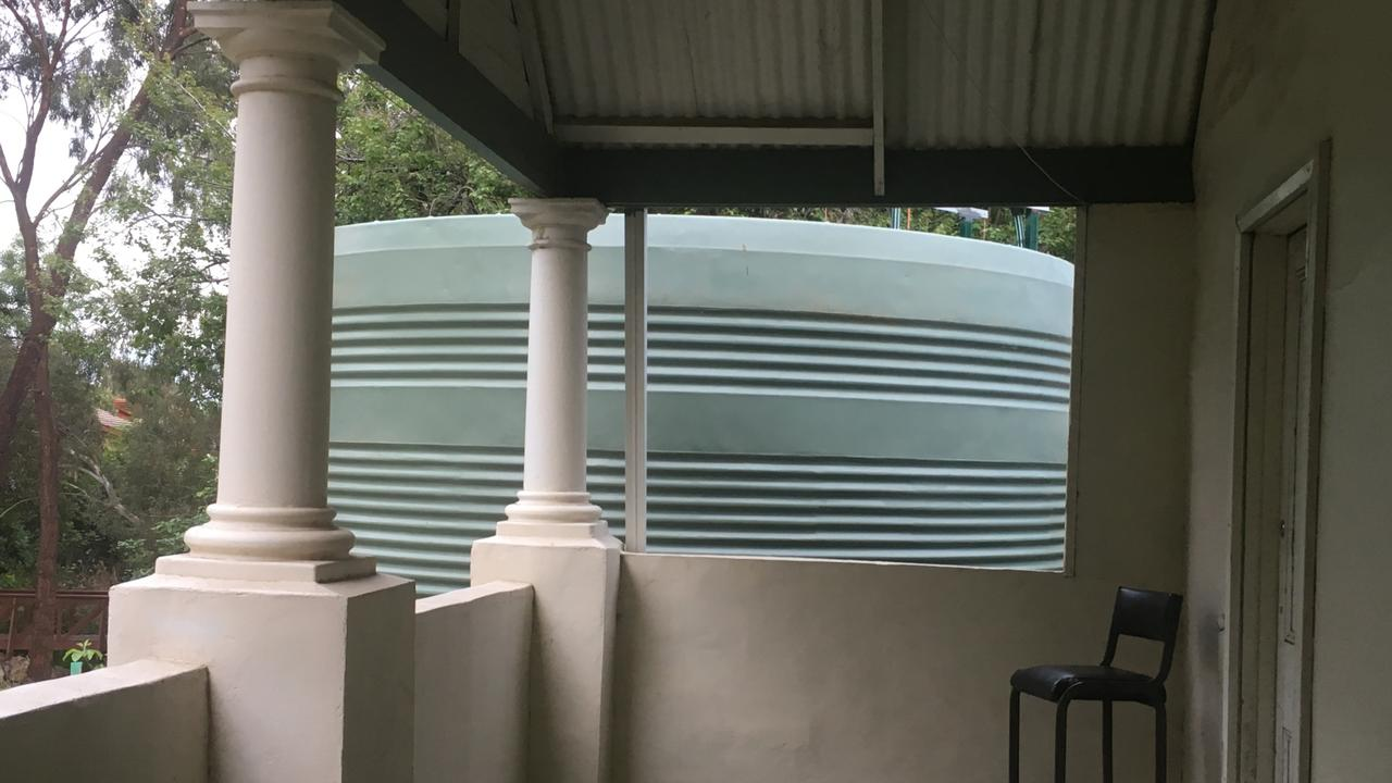 Mr Soda can touch the tank from his verandah. Picture: Branko Soda