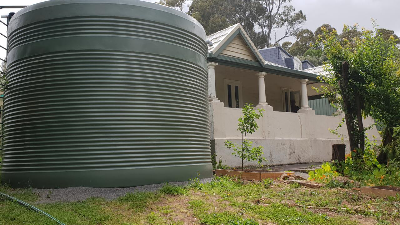 Branko Soda arrived home to find a rainwater tank almost touching his home. Picture: Colin James