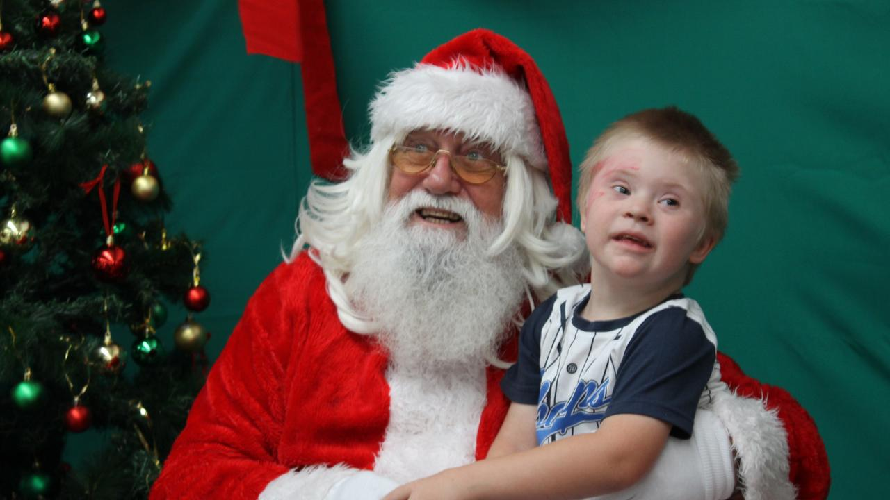 The Mackay Special Kids Christmas Party almost missed out on council funds this year (pictured: Michael Bennett with Santa).
