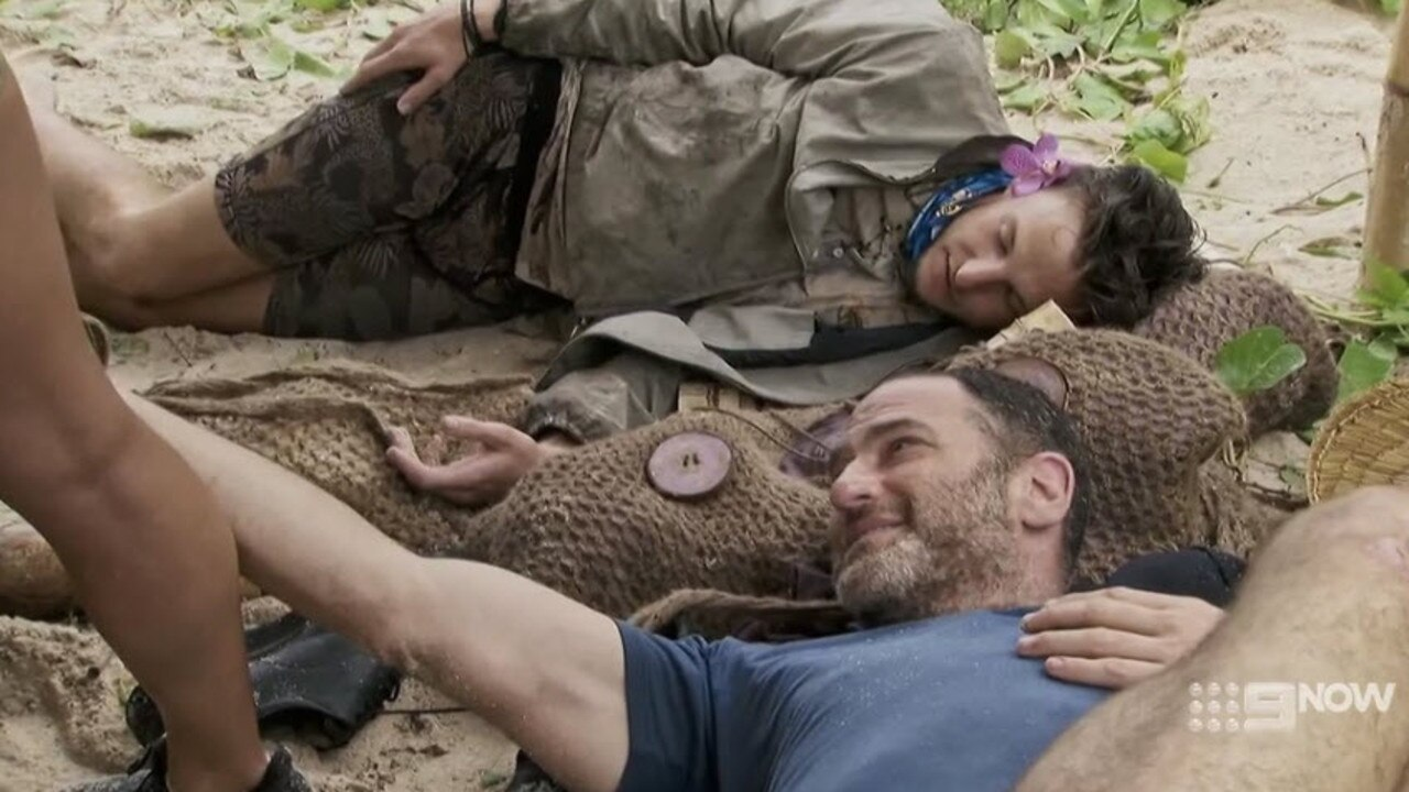 Dan patting contestant Missy's leg at camp.