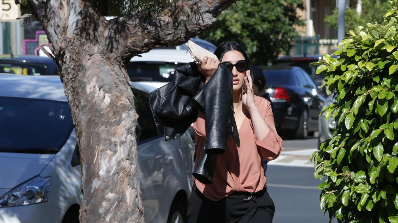 Jennifer Shewan pictured trying to hide her face from the camera outside Sutherland Court House.