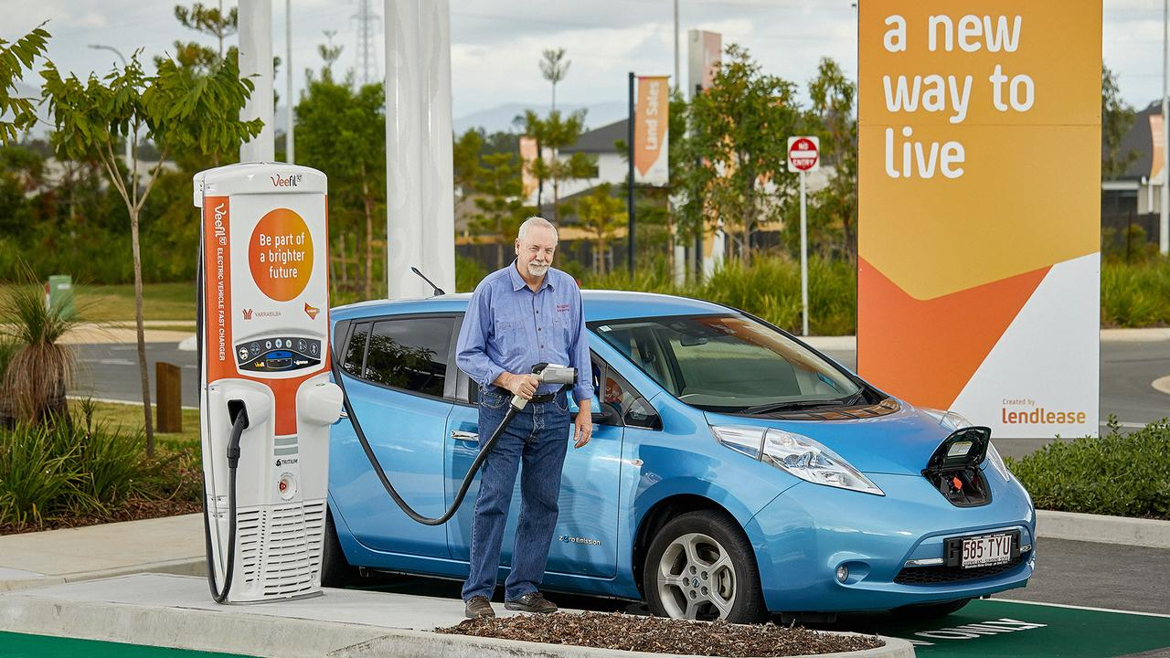 Yarrabilba resident Jim Barbey at the electric car charging bay, the first in a masterplanned estate in southeast Queensland.