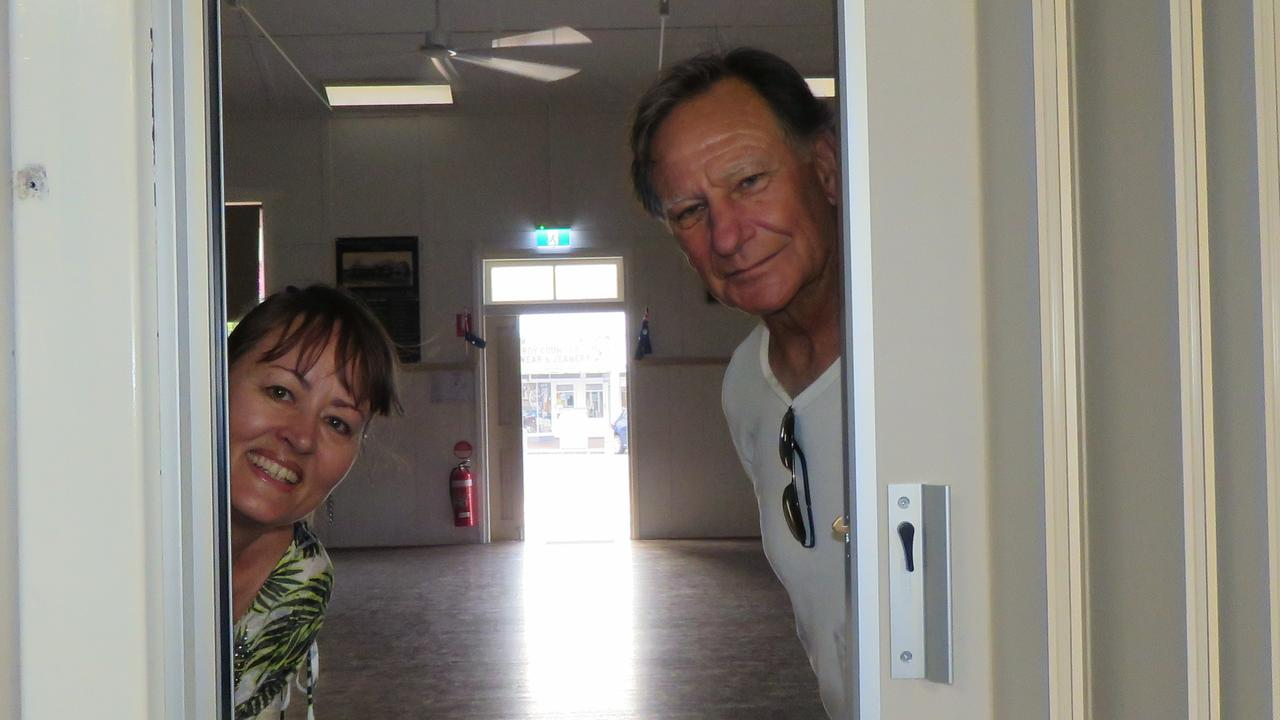 Cooroy Hall committee members Cathy Young and Phil McGrath with some of the new concertina doors.