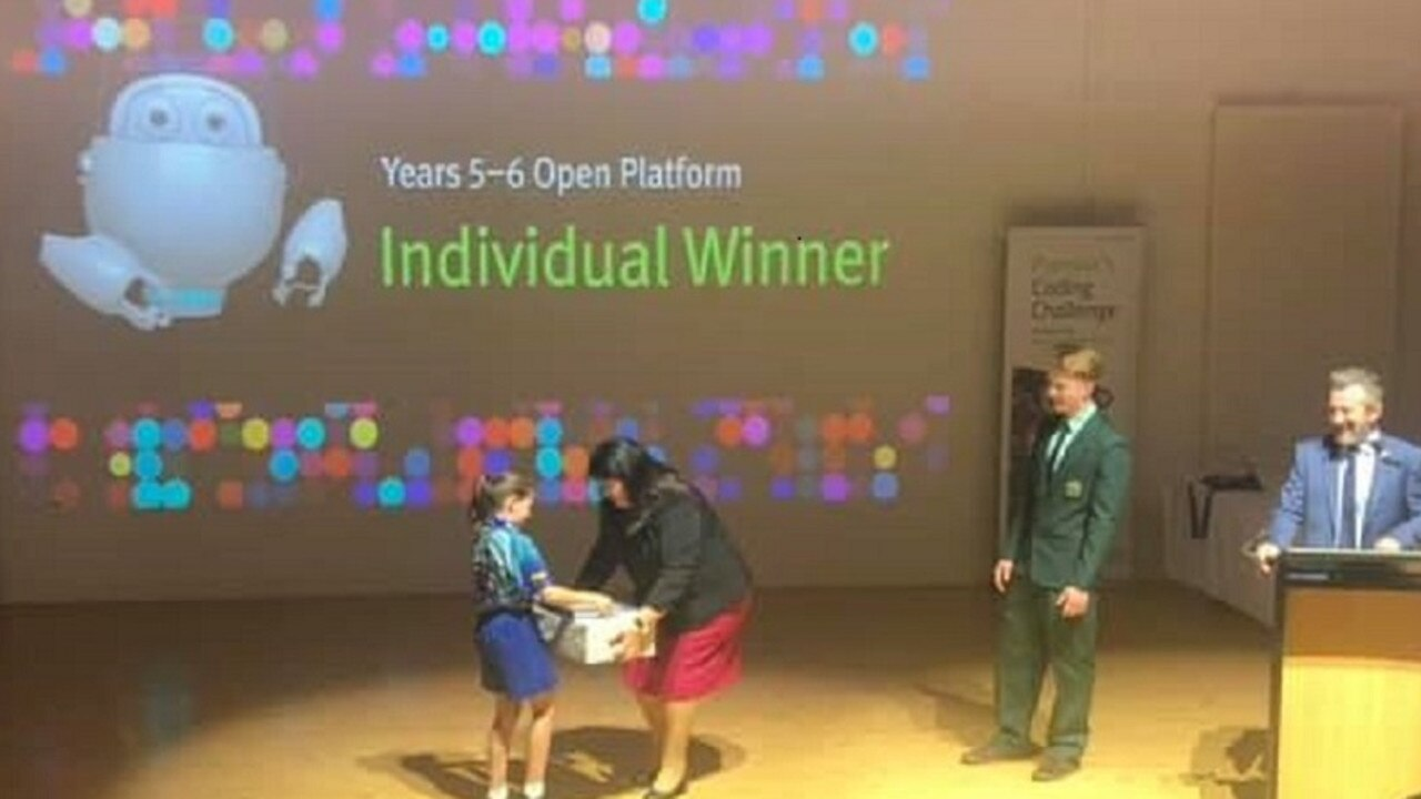 Indianna Kowalczyk receives her coding award from Minister Grace Grace.