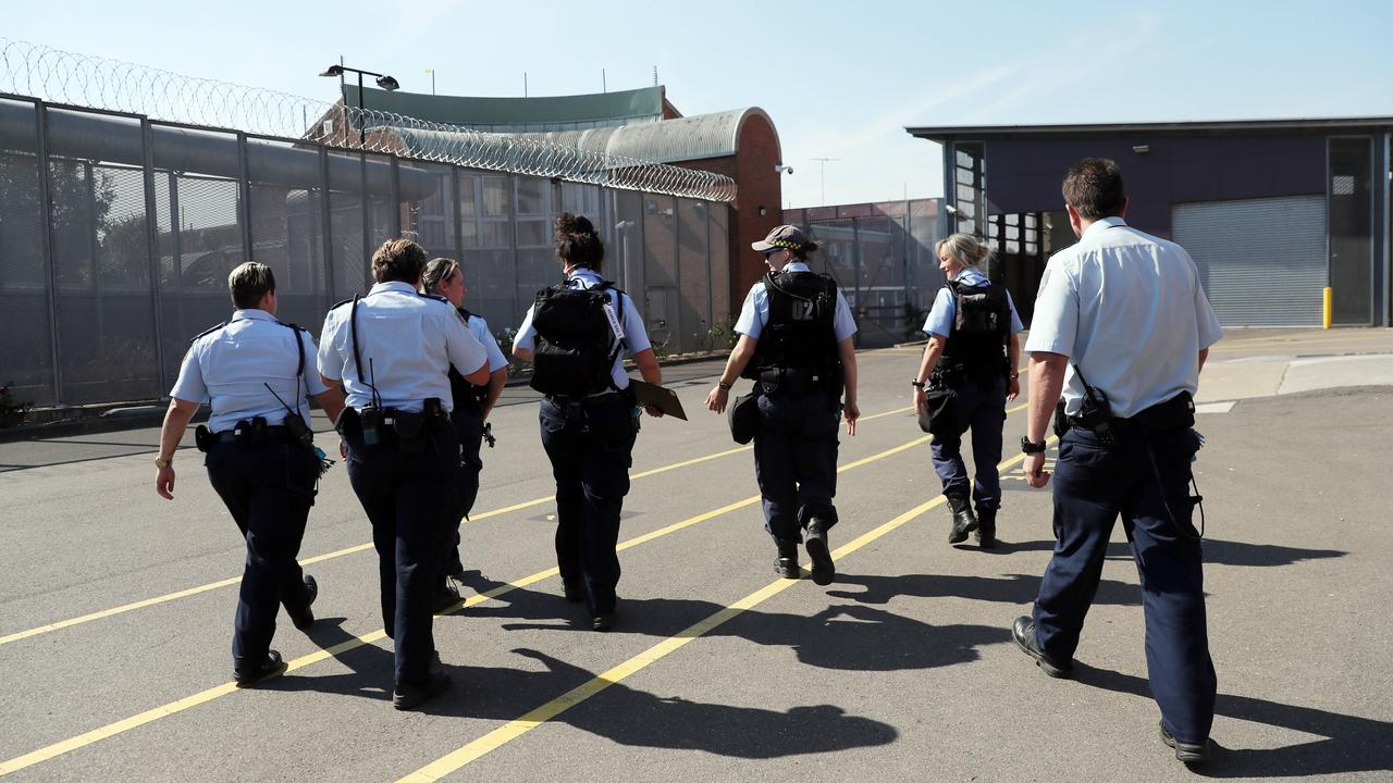 Corrections officers head towards a cell block to conduct a search of inmates cells at the Silverwater Jail womens facility. Picture: Richard Dobson