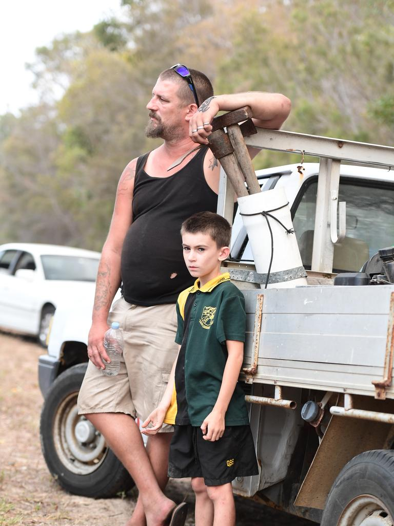Derek Carty and his son Dean Carty waiting on Woodgate Road for the all clear to return to the coastal township.