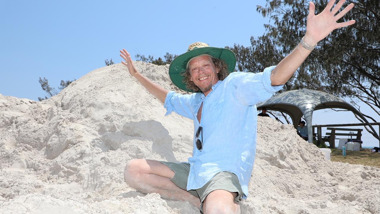 Arron McCormick sand sculpting at Bargara.