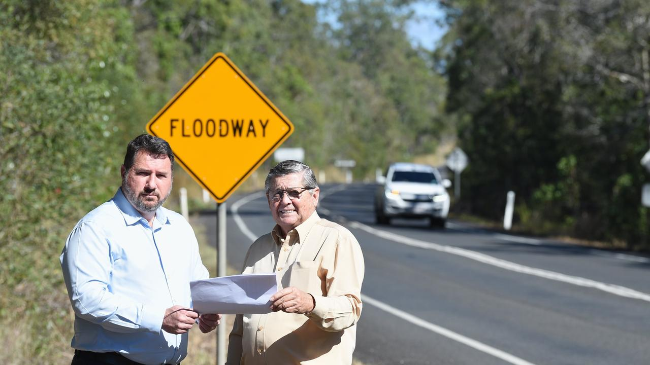 ROAD CUTS: Shadow Minister for State Development Andrew Powell along side Ted Sorensen who said the government was neglecting the region. Picture: Alistair Brightman