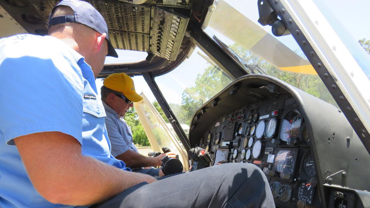 Simon, left and father John McDermott at the controls of the enw Guardian 1 helicopter at McDermott Aviation in Cooroy.