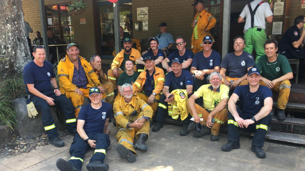 Maroochy River Brigade members and a relief crew from New Zealand took a smoko break after a tough morning fighting fires on the Noosa River North Shore. They were soon back into the fray rejoining a battle that had been on edge all afternoon.