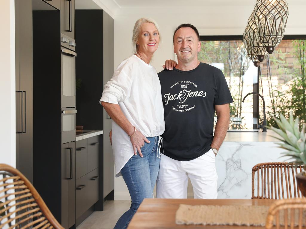 Pictured at their latest project house in Kellyville is professional are house flippers Kath and Chris Friedrich.