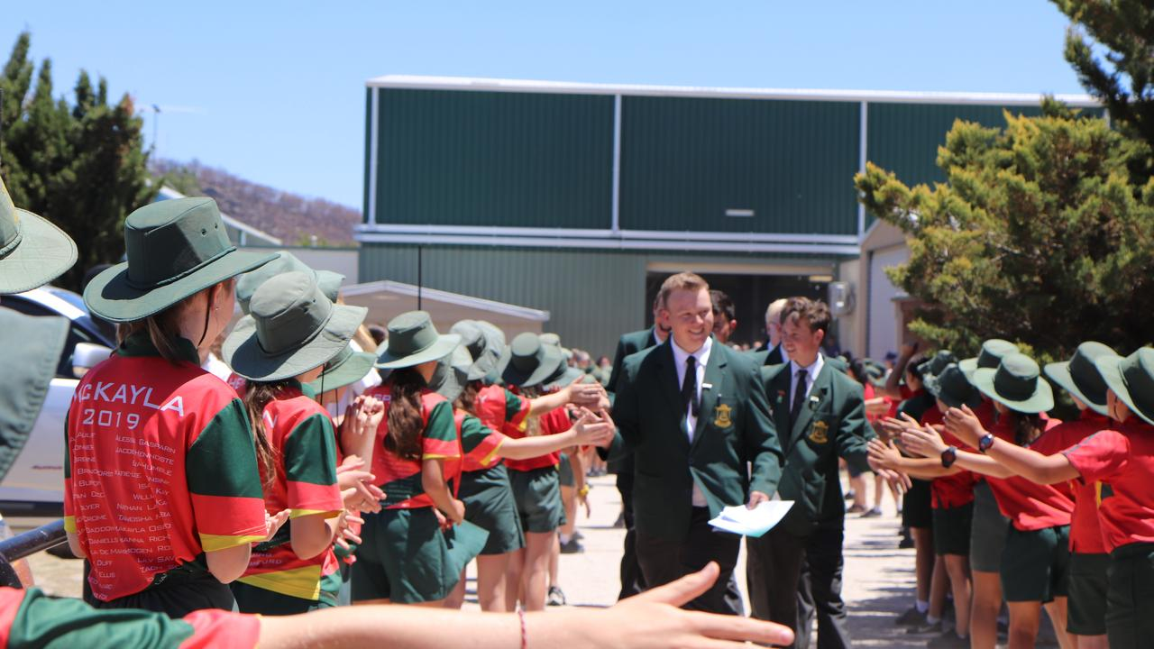 SCHOOL'S OUT: St Joseph's Year 12 students walking through the Guard of Honour