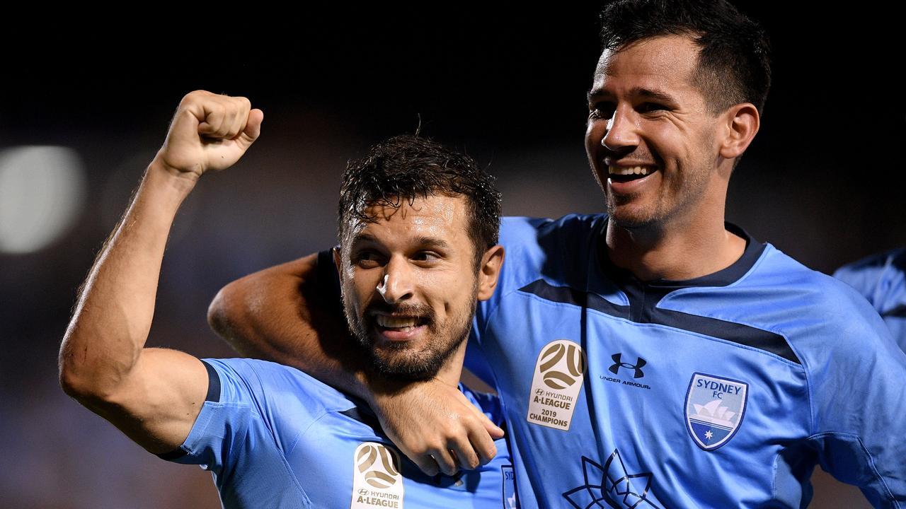 Barbarouses (L) celebrates with Sydney FC teammate Ryan McGowan. Picture: AAP