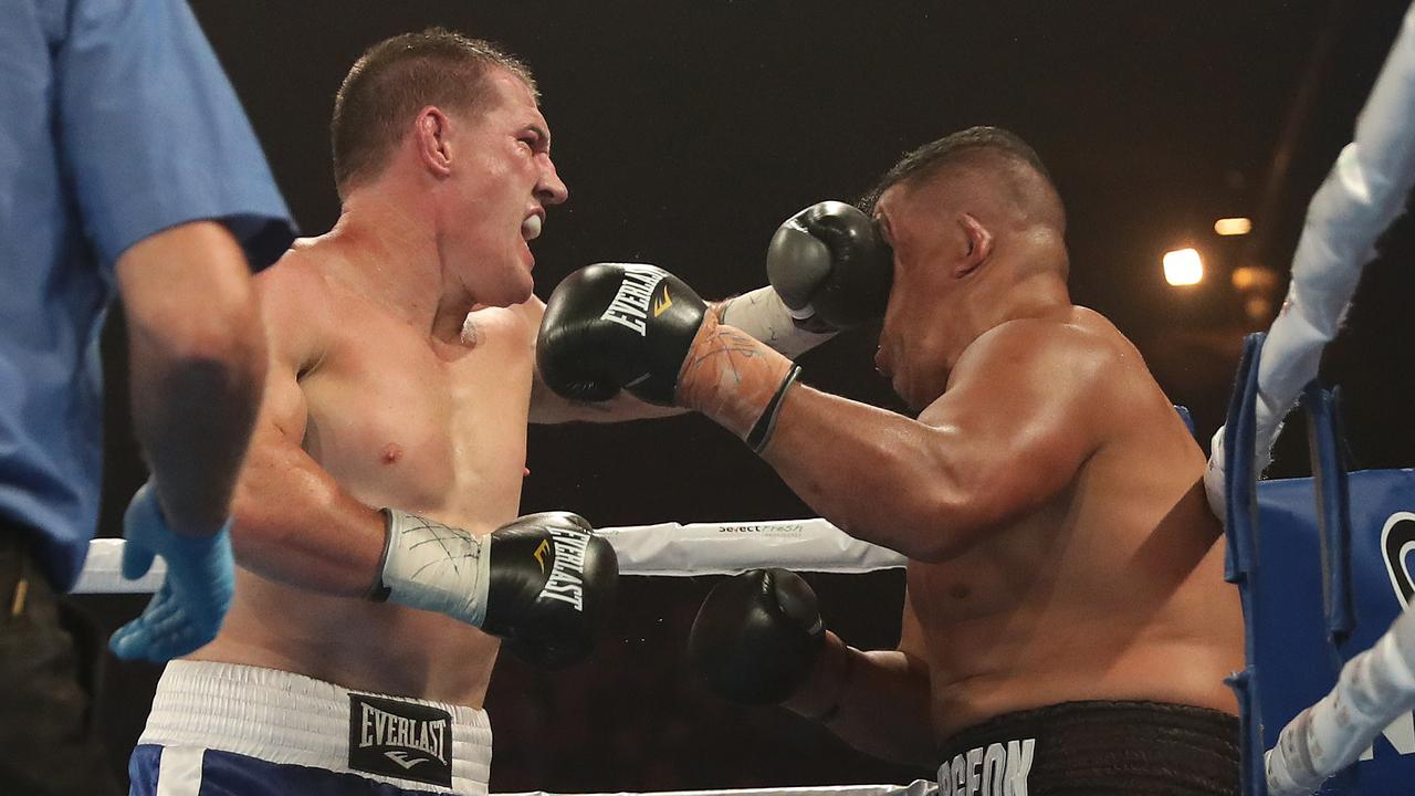 Paul Gallen hammers John Hopoate in their bout. Picture: Brett Costello