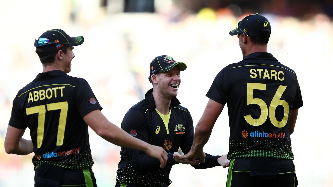 Steve Smith of Australia congratulates Mitchell Starc of Australia on taking a catch during the T20 International Cricket match between Australia and Pakistan at Optus Stadium, in Perth, Friday, November 8, 2019. (AAP Image/Gary Day) NO ARCHIVING, EDITORIAL USE ONLY, IMAGES TO BE USED FOR NEWS REPORTING PURPOSES ONLY, NO COMMERCIAL USE WHATSOEVER, NO USE IN BOOKS WITHOUT PRIOR WRITTEN CONSENT FRO