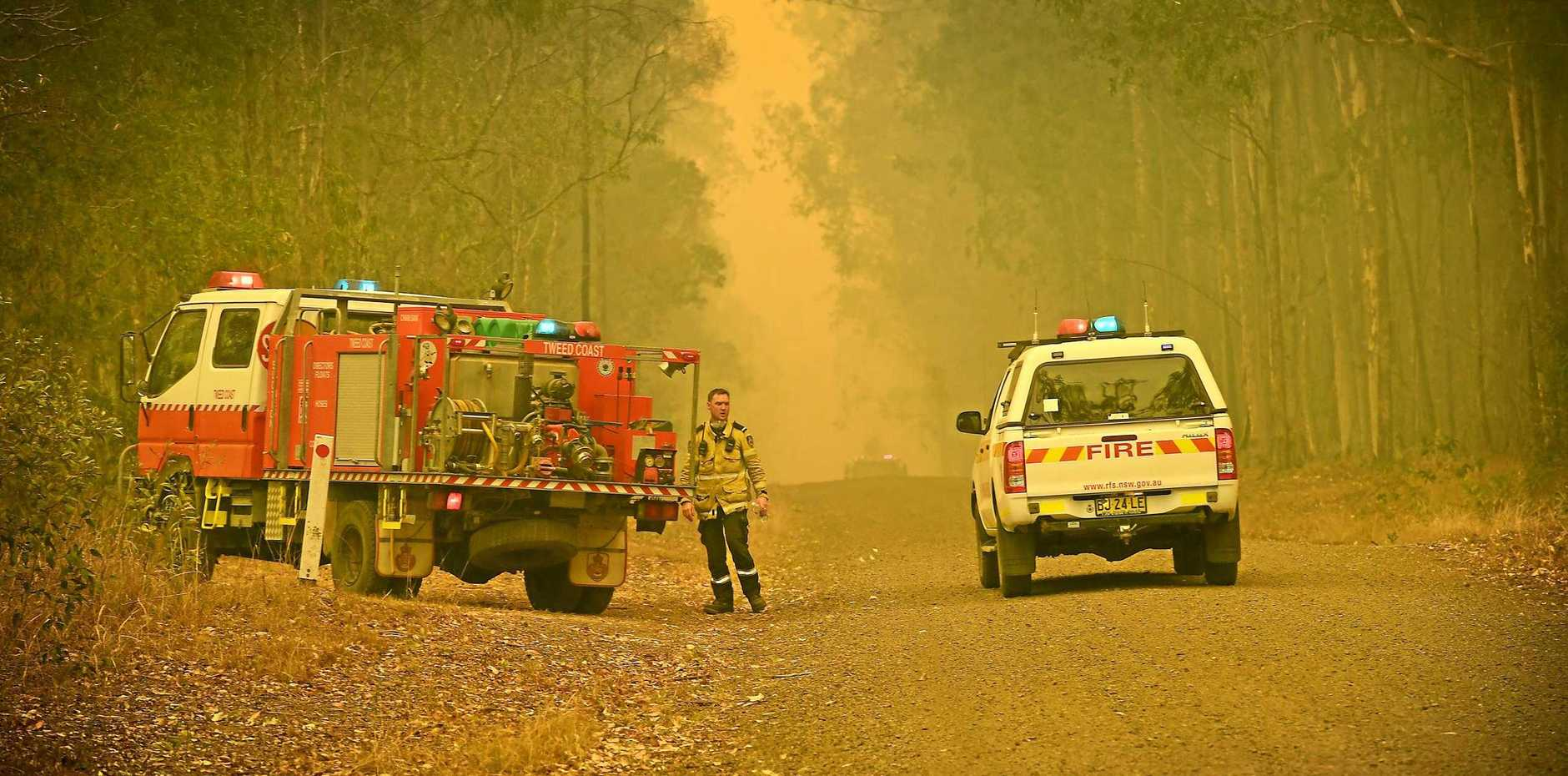 Severe fire conditions on Myall Creek road at Bora Ridge.