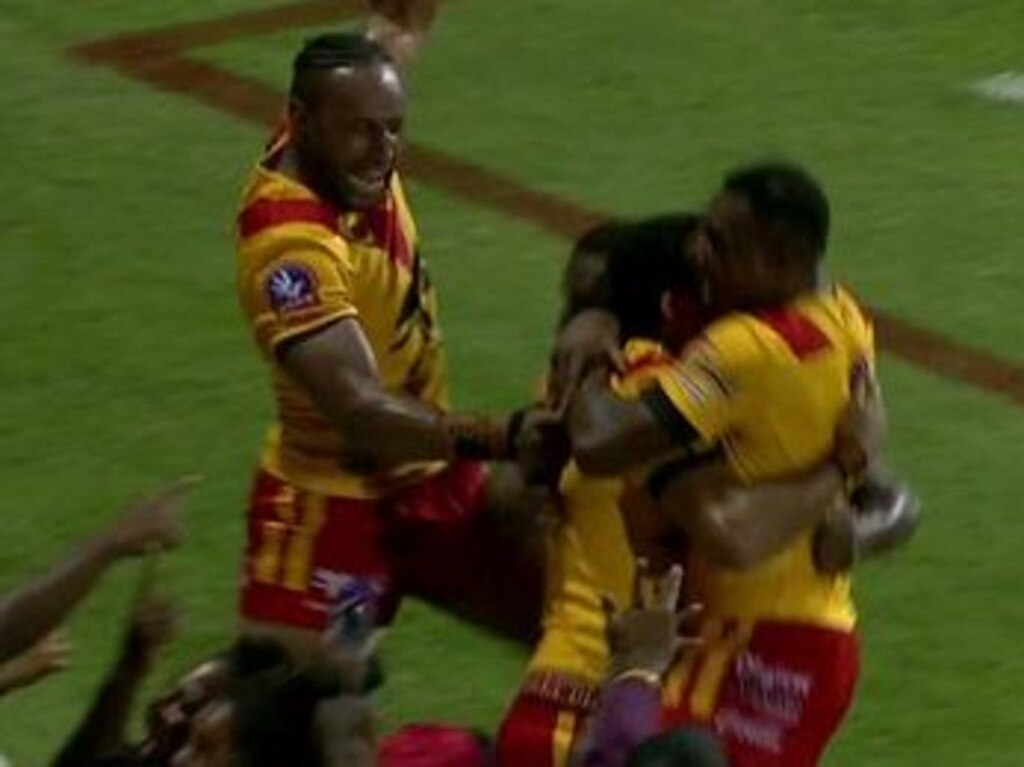 Papua New Guinea celebrate a try in their win over Great Britain.