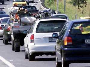 Motorway blocked after car flips