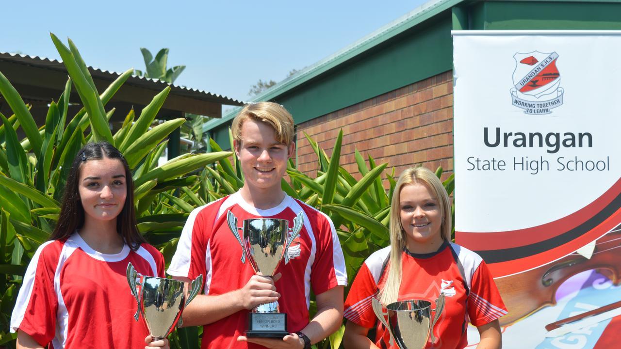 Winning Urangan captains Mikaela Scholz (junior girls), Ethan Laskowski (senior boys) and Jess Gilbert (senior girls) with the Challenge Cup trophies.