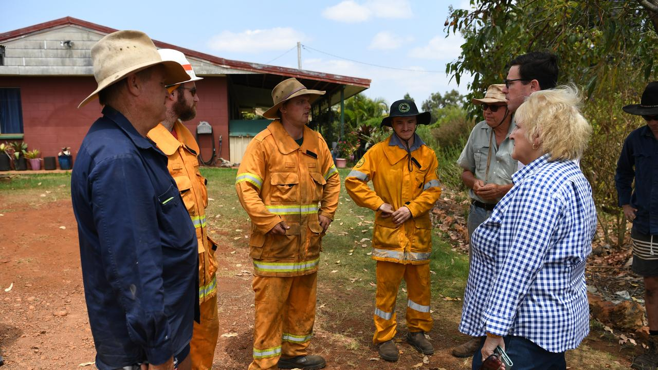 Michelle Landry and David Littleproud speak with farmer Robert Sikes and local volunteer firefighters.