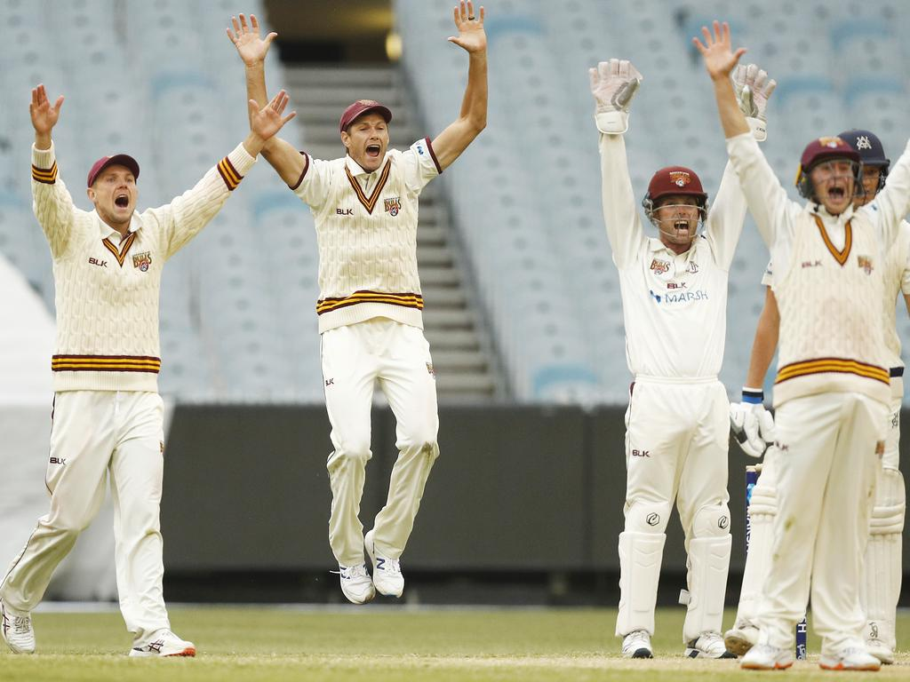 Queensland players appeal the wicket of Chris Tremain.