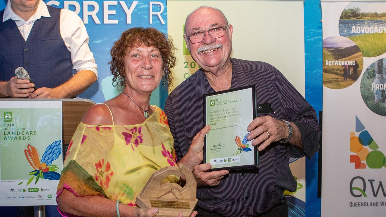 Central Queensland Soil Health Systems spokeswoman Sharon Dwyer accepting the Australian Government Innovation in Agriculture Land Management Award from Leichhardt MP Warren Entsch.