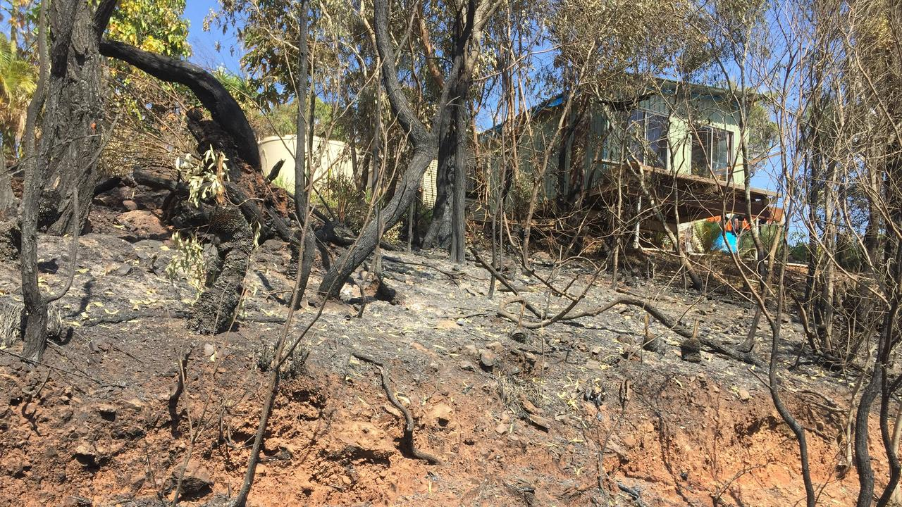 The charred remains of bush shows the fire all but enveloped the Sikes' hilltop home