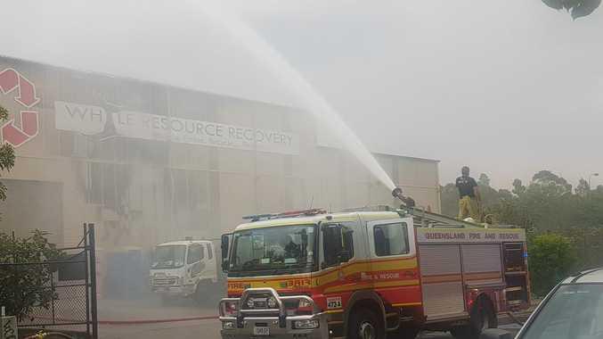 7 crews, excavator battle raging fire at Coast business