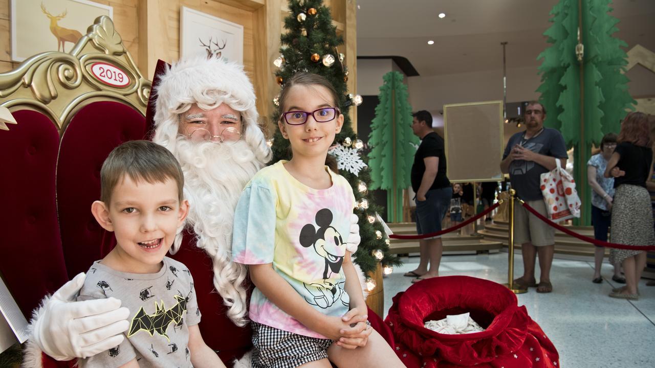 Channing Daniel, 5, and his sister Peyton Daniel, 8, meet Santa at Grand Central. Picture: Nev Madsen. Saturday, 16th Nov, 2019.
