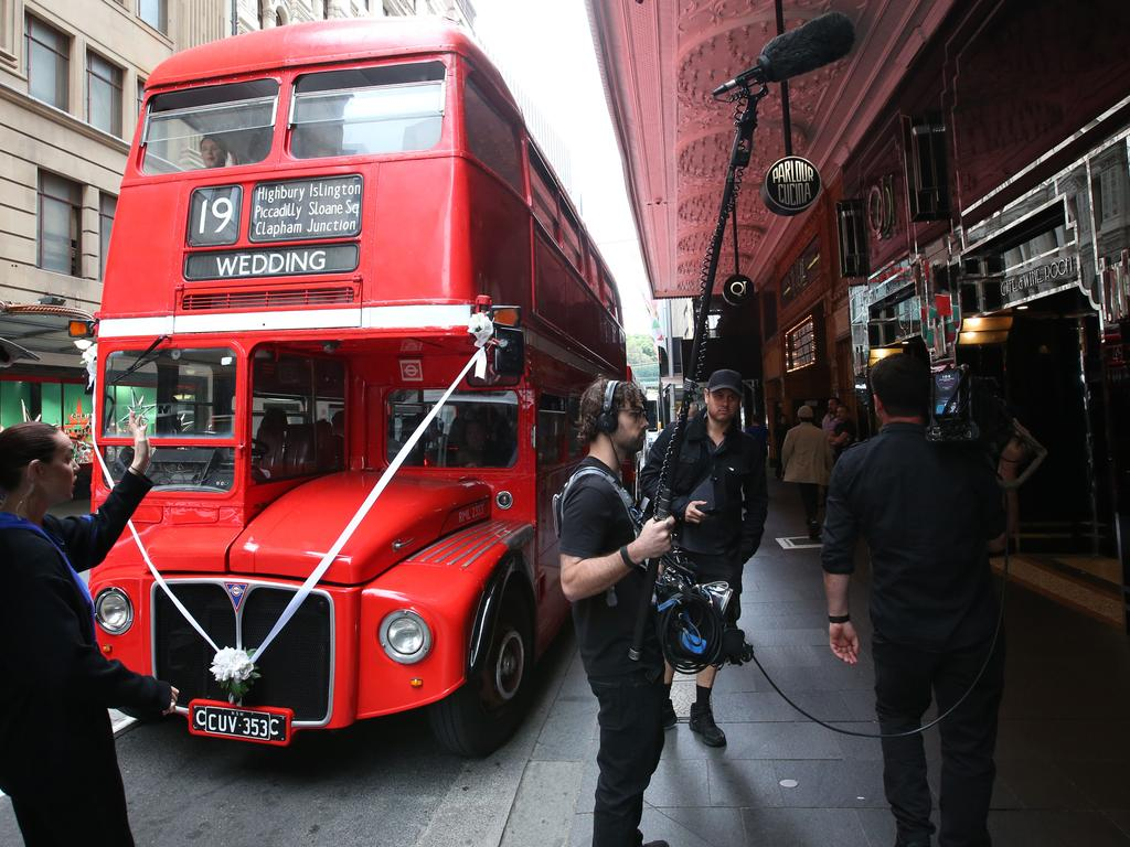 Guests of the Jules and Cam were taken to the wedding venue in a bus. Picture: Damian Shaw