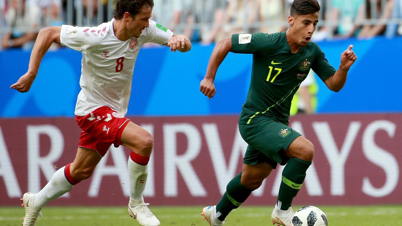 Socceroo Daniel Arzani on the run from Denmark' Thomas Delaney. Picture: Toby Zerna
