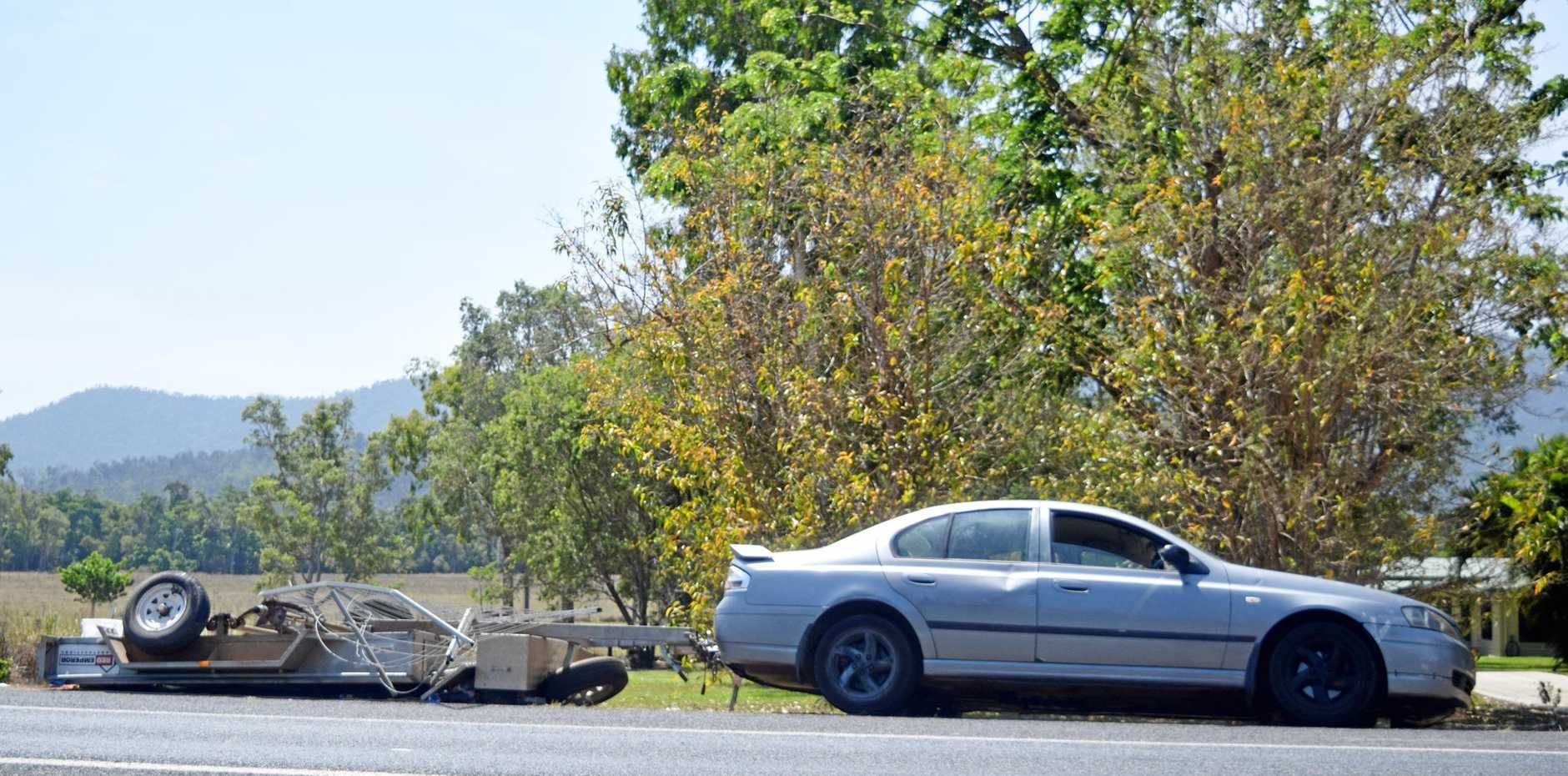 A trailer, being towed by a car, tipped over on Shute Harbour Rd in Cannon Valley, this afternoon.
