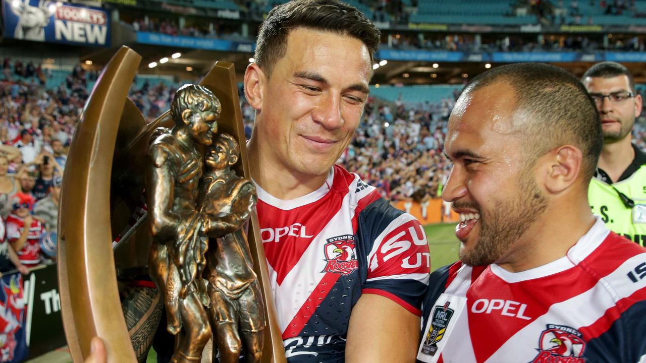 Rooster's Sonny Bill Williams celebrates the 2013 grand final win with Sam Moa.