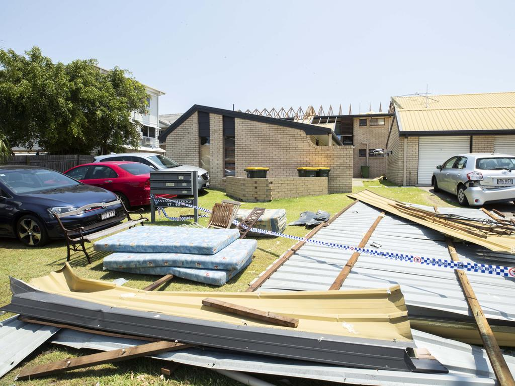 Debris lies strewn across the yard at a block of flats at Mooloolaba that lost its roof during the wild hailstorm. Picture: Lachie Millard