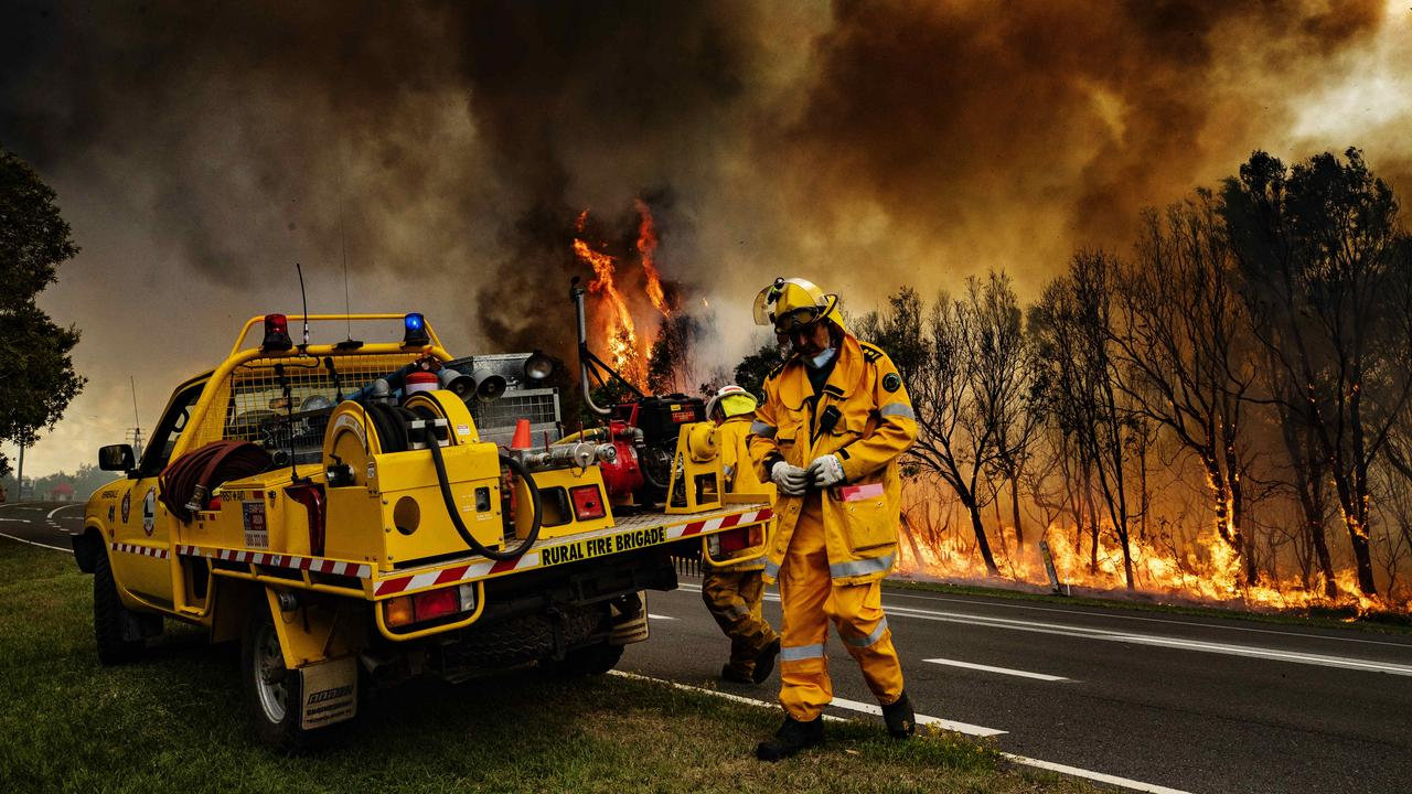 Firefighters on the scene of the Peregian Beach bushfire, which was allegedly started by two teenagers. Picture: Lachie Millard