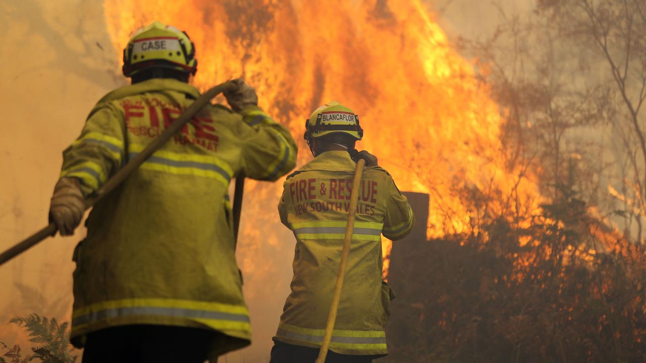 Firefighters battle the blaze at Rainbow Flat on NSW. Picture Gary Ramage